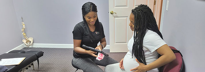 Chiropractor Roswell GA Keisha Bates with Pregnant Woman